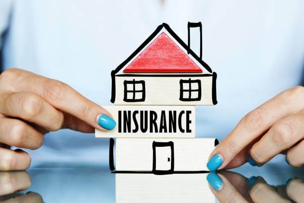 image shows a cutout of a house with Insurance written across