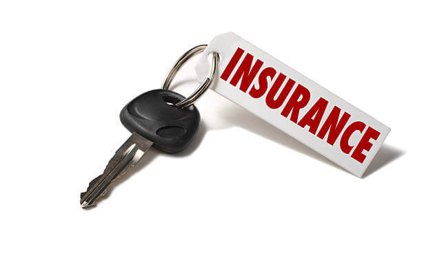 image depicts a key with a tag that says Insurance