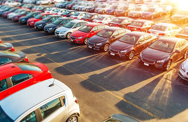 image depicts multiple vehicles for sale at a car dealership