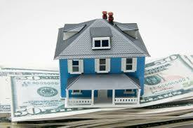 image shows a home sitting on cash