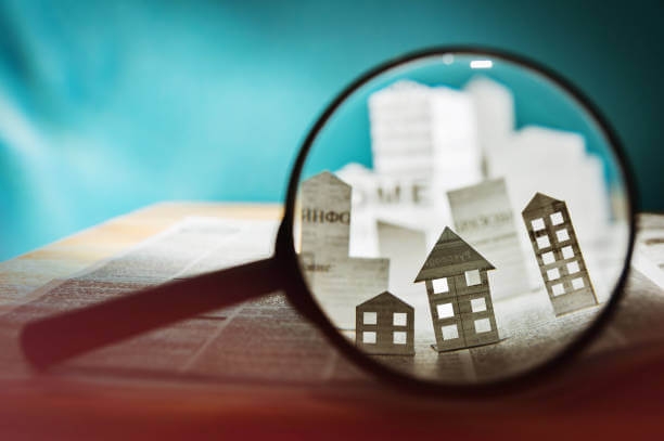 image shows magnify glass over houses
