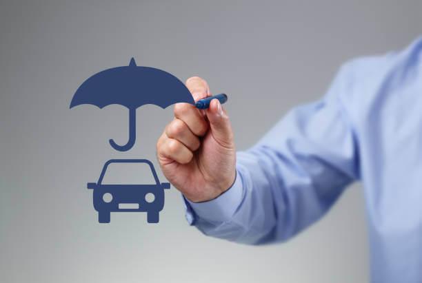 image depicts a individual drawing a umbrella over a car