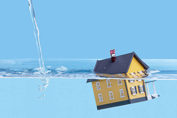 image shows house under water depicting home water damage