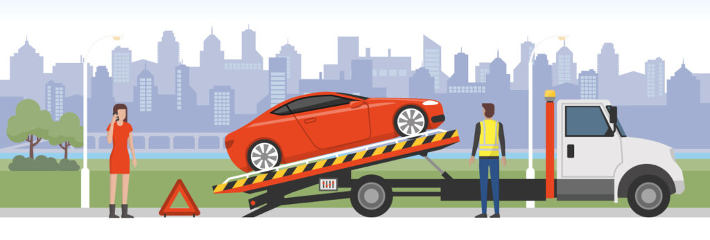 Roadside assistance and car insurance concept: broken car on a tow truck and woman calling emergency services