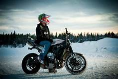 image depicts a rider with an alaskan backround