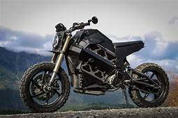 image depicts a motorcycle with a mountainous view