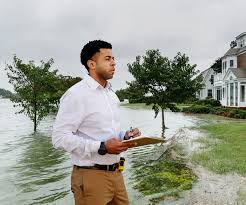 image shows gentleman assessing damage done by a flood
