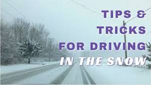 image shows snowy icy road with wording that says tips for driving in the snow