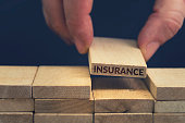 image depicts building blocks with the word Insurance