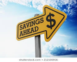 image depicts a street sign with the words savings ahead