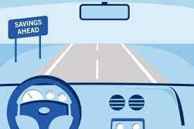 image depicts a vehicle driving down a straight road with a sign that reads savings ahead