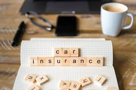 image shows scrabble pieces spelling out car insurance