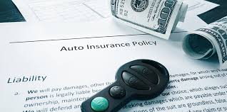 image shows auto insurance policy paperwork with car key and money