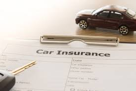 image shows car insurance paperwork with key and car