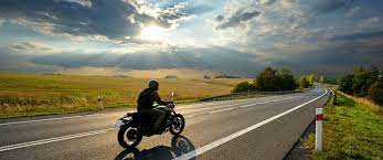 image depicts a rider driving a motorcycle