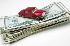 Picture of a car on top of a stack of money implying savings